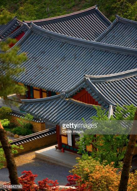 rooftops of buddhist temple in south korea - south korea stock pictures, royalty-free photos & images