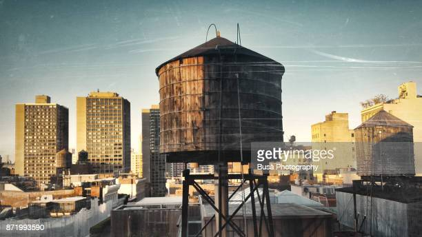 rooftops of manhattan, with iconic water storage tanks, in the soho area. new york city, usa - water tower storage tank stock pictures, royalty-free photos & images