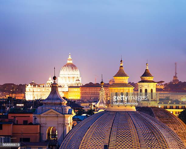 Rooftops of Rome and St Peter's dome at night