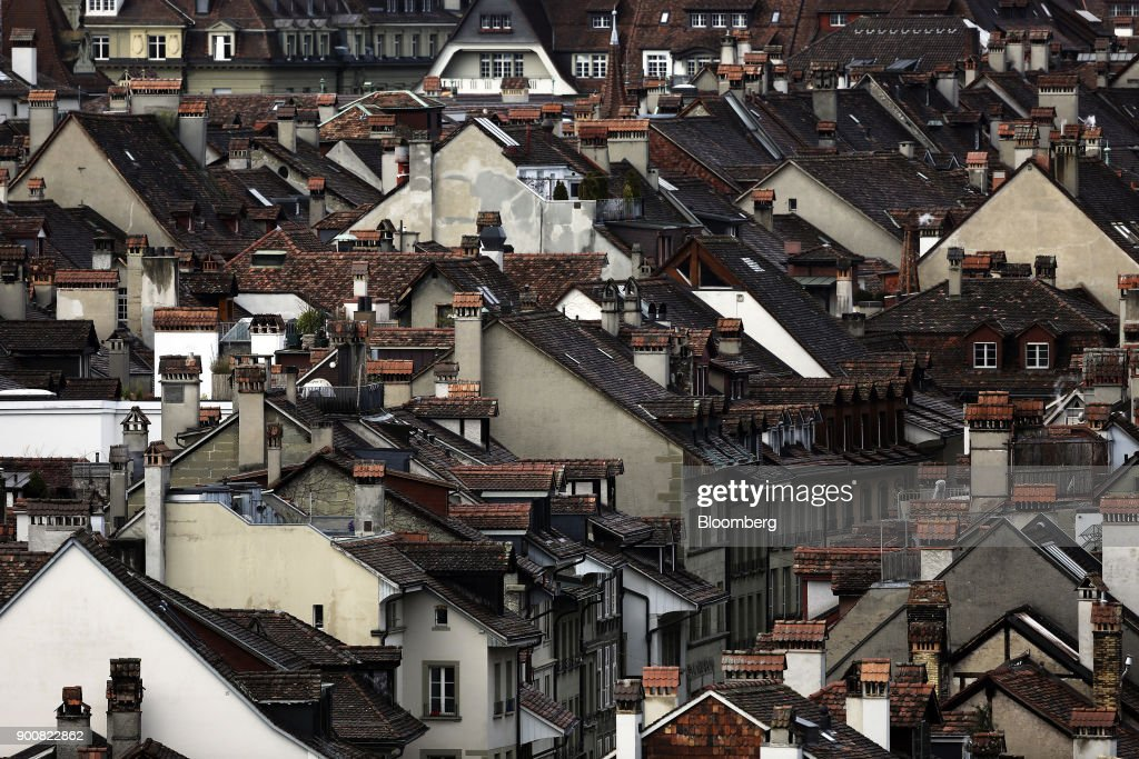 Rooftops of traditional Swiss residential properties stand in the old town of Bern, Switzerland, on Monday, Jan. 1, 2018. The supply of uninhabited apartments for rent has increased faster than the Swiss population has grown. Photographer: Stefan Wermuth/Bloomberg via Getty Images