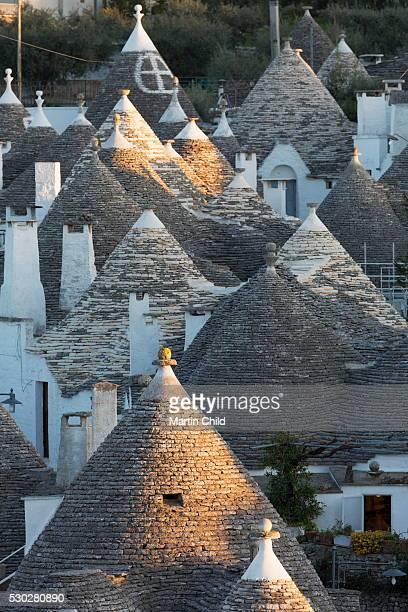 rooftops of traditional trullos (trulli) in alberobello, unesco world heritage site, puglia, italy, europe - alberobello stock photos and pictures