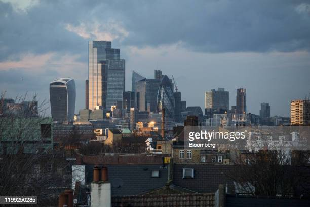 Rooftops stand beyond skyscrapers including 20 Fenchurch Street also known as the WalkieTalkie 22 Bishopsgate office tower the Leadenhall building...