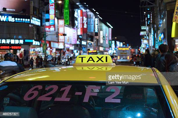 CONTENT] A roofview of a city taxi in Taiwan