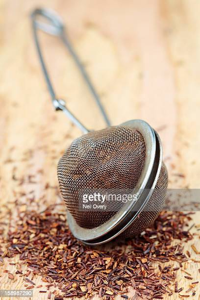 Rooibos tea in a tea strainer