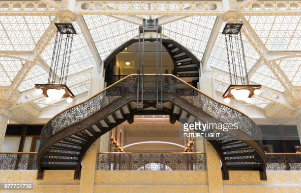 rookery building, interior staircase of the light court, chicago, illinois, usa, north america - rookery chicago stock pictures, royalty-free photos & images