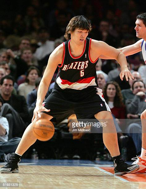 Rookie center Ha SuengJin of the Portland Trail Blazers dribbles the ball against the New York Knicks on January 9 2005 at Madison Square Garden in...