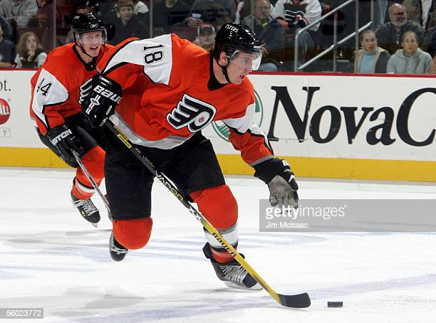 Rookie center Mike Richards of the Philadelphia Flyers skates up ice with teammate Joni Pitkanen against the Florida Panthers during their game on...