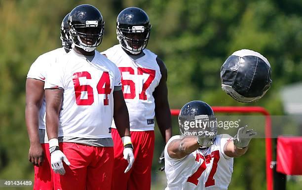 Rookie defensive end Ra'Shede Hageman of the Atlanta Falcons runs drills during rookie minicamp at the Atlanta Falcons Training Facility on May 16...