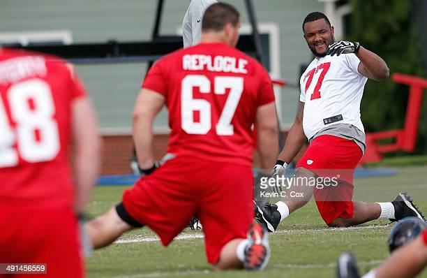 Rookie defensive end Ra'Shede Hageman of the Atlanta Falcons stretches during rookie minicamp at the Atlanta Falcons Training Facility on May 16 2014...