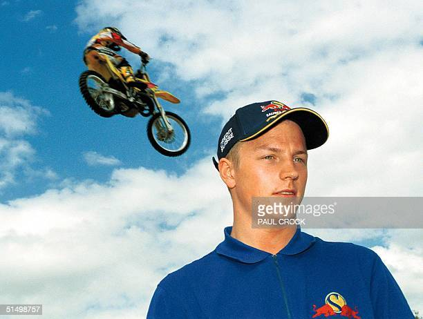 Rookie F1 driver Finland's Kimi Raikkonen poses 28 February 2001 for the press during his preparation for his first Formula One Grand Prix start with...