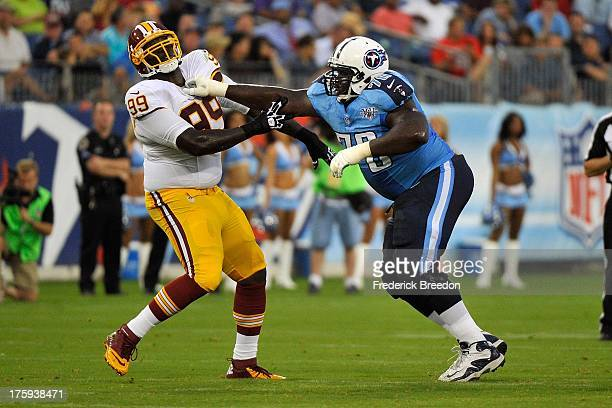 Rookie guard Chance Warmack of the Tennessee Titans blocks Jarvis Jenkins of the Washington Redskins during a preseason game at LP Field on August 8...
