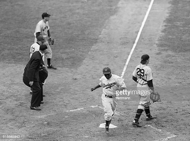 Rookie Jackie Robinson crosses the plate in the second inning of a World Series game against the New York Yankees