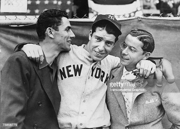 Rookie Joe DiMaggio, center, hugs his brothers Vince, left, and Dom, before the start of the 1936 World Series in New York in October.