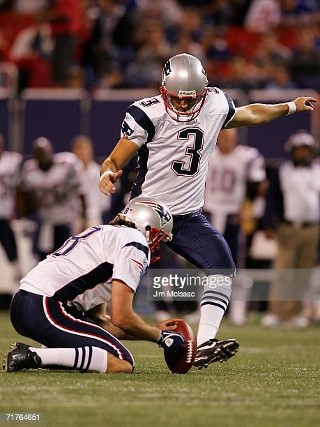 Rookie kicker Stephen Gostkowski of the New England Patriots kicks an field goal against the New York Giants as teammate Josh Miller holds during...