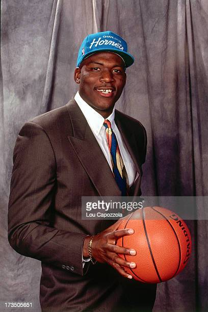 Rookie Larry Johnson of the Charlotte Hornets poses with a basketball for a photo shoot during the 1991 NBA Draft at Madison Square Garden in New...