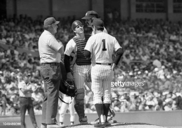 Rookie Mike Heath and manager Billy Martin confer with starting pitcher Dick Tidrow on the mound in the 7th inning of game against the White Sox....