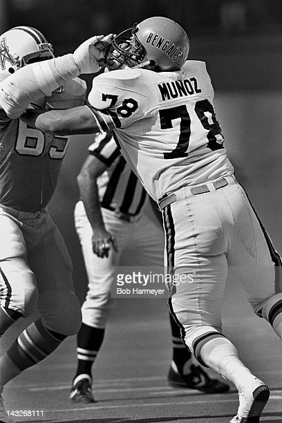 Rookie offensive tackle Anthony Munoz of the Cincinnati Bengals plays against defensive lineman Andy Dorris of the Houston Oilers on September 28 at...