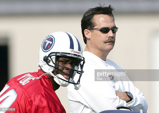 Rookie quarterback Vince Young lines up near head coach Jeff Fisher during the Tennessee Titans Mini camp on May 5 2006 at Baptist Sports Park in...