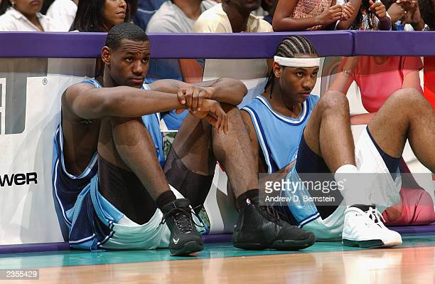 Rookie Team member LeBron James of the Cleveland Cavaliers sits with fellow Rookie Team member Carmelo Anthony of the Denver Nuggets during the 18th...