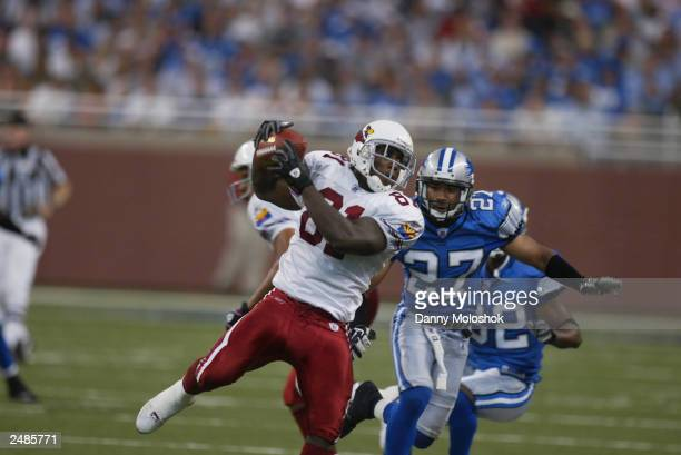 Rookie wide receiver Anquan Boldin of the Arizona Cardinals catches the ball under pressure from cornerback Jimmy Wyrick of the Detroit Lions at Ford...