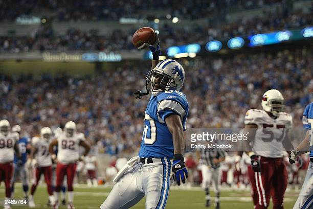 Rookie wide receiver Charles Rogers of the Detroit Lions celebrates his second touchdown of the day against the Arizona Cardinals at Ford Field on...