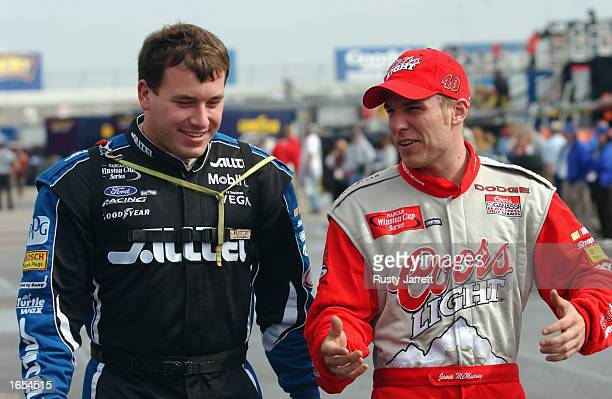 Rookies Ryan Newman driver of the Penske Racing ALLTEL Ford talks to Jamie McMurray driver of Chip Ganassi Racing Coors Light Dodge during the NASCAR...