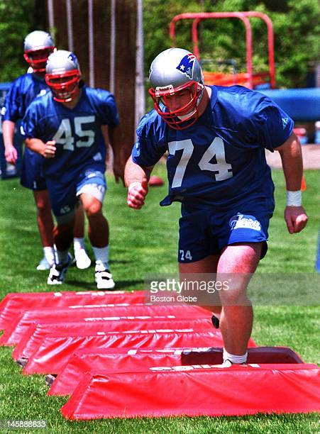Rookies Tedy Bruschi and former BC standout Chris Sullivan participate in drills at today's rookie camp in Wrentham