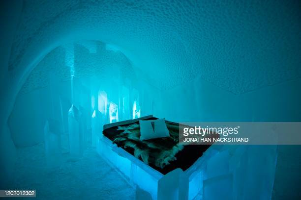 Room at the Ice Hotel in the village of Jukkasjarvi, near Kiruna, in Swedish Lapland is pictured on February 9, 2020. - The Ice Hotel gets new design...