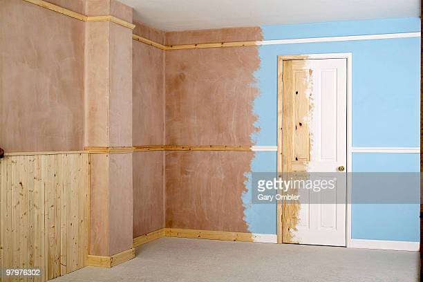 Room being painted and decorated using wood panelling and rails