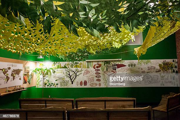 A room for guest tours features educational posters and a live cocoa tree at the Theo Chocolate factory in Seattle Washington US on Monday Feb 2 2015...