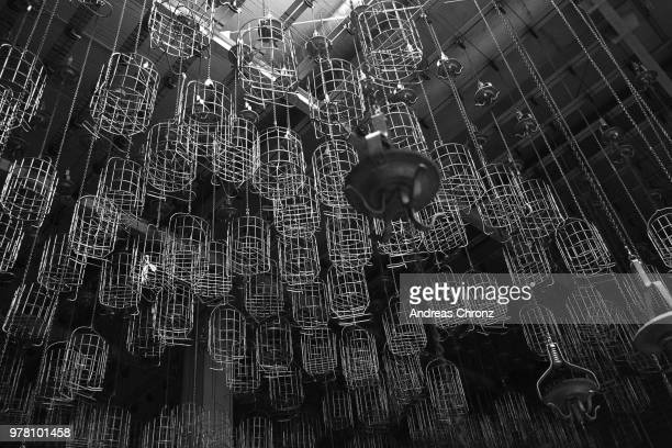 room full of baskets hanging from ceiling in coal mine, essen, dusseldorf, germany - ruhr stock pictures, royalty-free photos & images