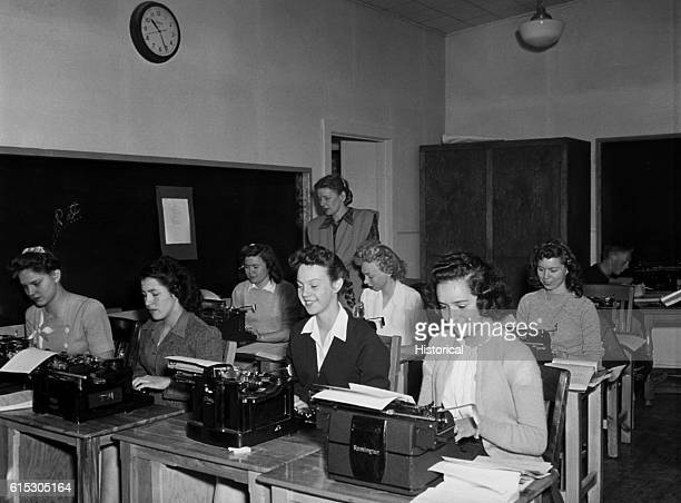 A room full of typists works on typewriters at Lawrence Livermore National Laboratory a nuclear development site
