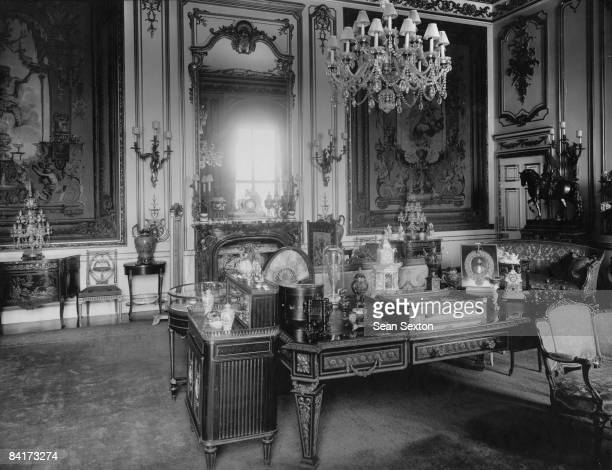 A room in Buckingham palace decorated in the Oriental style with a portrait of King George IV on the desk circa 1920