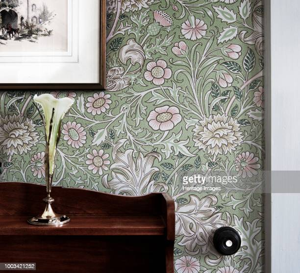 Room refurbished in Arts and Crafts style Mount Grace Priory East Harlsey North Yorkshire circa 1980circa 2017 A vase and sideboard sit in front of...
