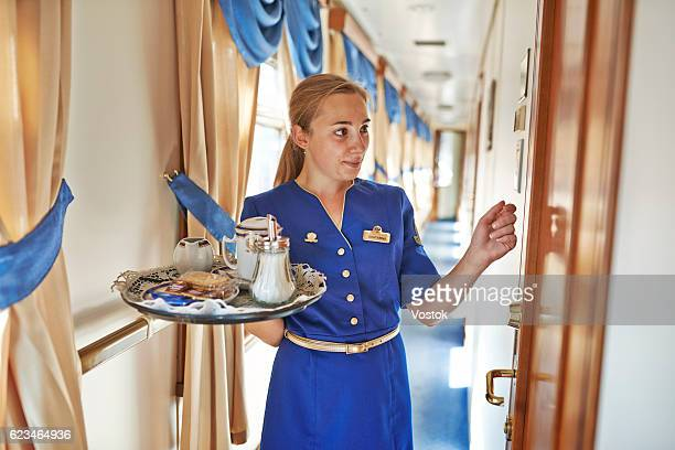 room service at the luxury trans-siberian express train - aquila reale foto e immagini stock