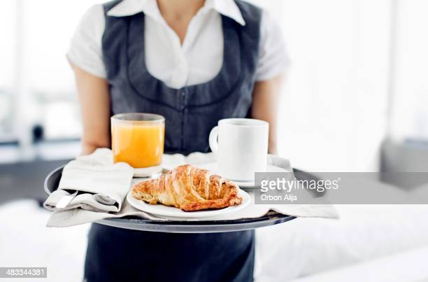 room service hotel staff carries breakfast tray - hotel stock pictures, royalty-free photos & images