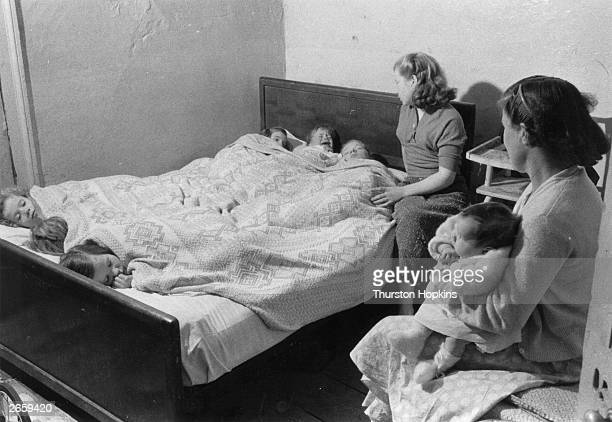 A room shared by seven children and two adults in Frank Street Liverpool Original Publication Picture Post 8995 Liverpool Slums unpub