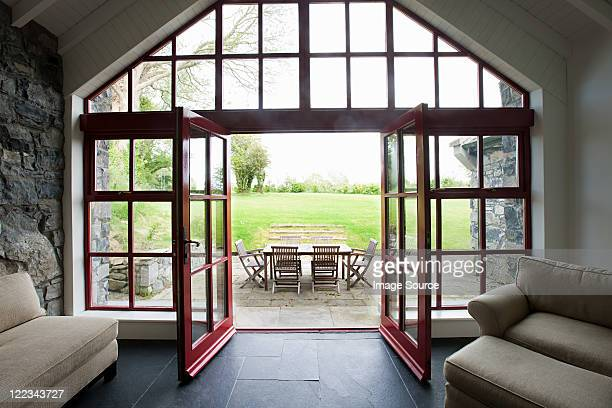Room with doors open onto patio