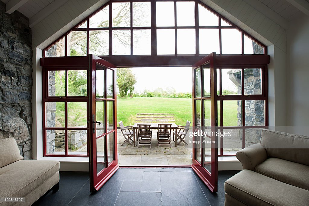 Room with doors open onto patio & French Doors Stock Photos and Pictures | Getty Images pezcame.com