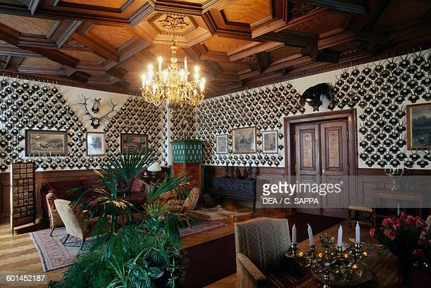 Room with hunting trophies wood panelling and wooden ceiling Konopiste castle Czech Republic 19th century