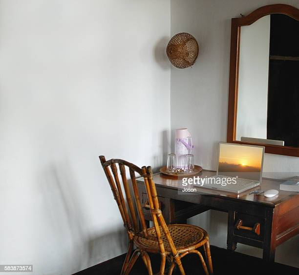 room with laptop on table, sunset as screen saver (bali, indonesia) - screen saver stock photos and pictures
