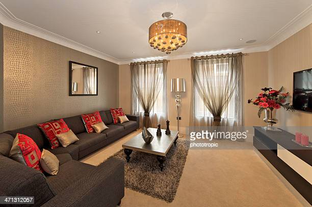 TV room with red cushions