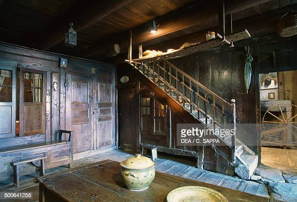 Room with staircase Farm Pierre Allegre Museum of rural life in 19th century RuynesenMargeride Auvergne France