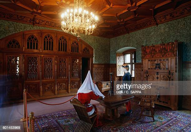Room with wood panelling and mannequins evoking ghostly legends Bojnice castle Slovakia 12th19th century