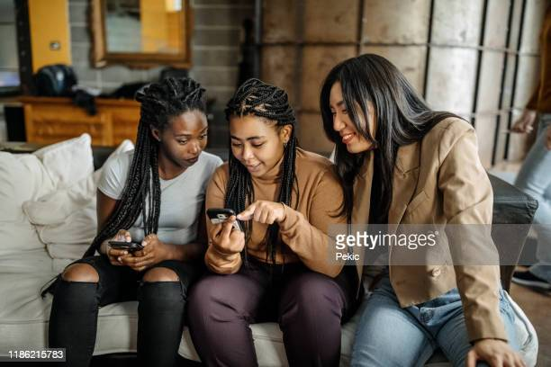 roommates having fun on social media - online dating stock pictures, royalty-free photos & images