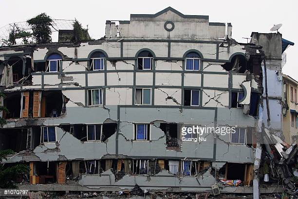 Rooms are exposed through the facade of building damaged by yesterday's earthquake on May 13 2008 in Dujiangyan Sichuan province southwest China A...