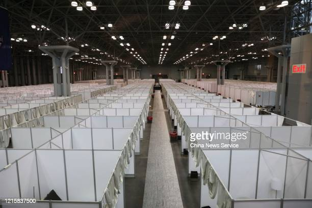 Rooms for patients are set up at Jacob Javits Convention Center, which is arranged as a temporary hospital amid the coronavirus outbreak, on March...