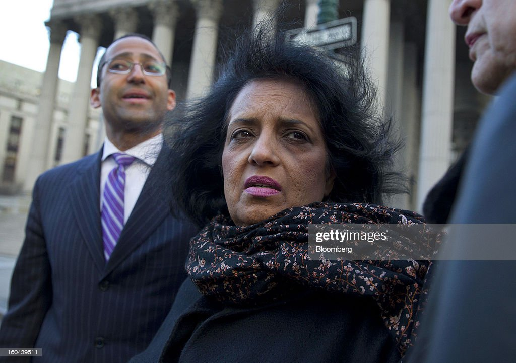 Roomy Khan, a former Intel Corp. executive, center, exits federal court with her attorney Stanislao German, left, following a sentencing hearing in New York, U.S., on Thursday, Jan. 31, 2013. Khan, twice convicted of passing illegal tips to Raj Rajaratnam, was sentenced to one year in prison today. Photographer: Jin Lee/Bloomberg via Getty Images