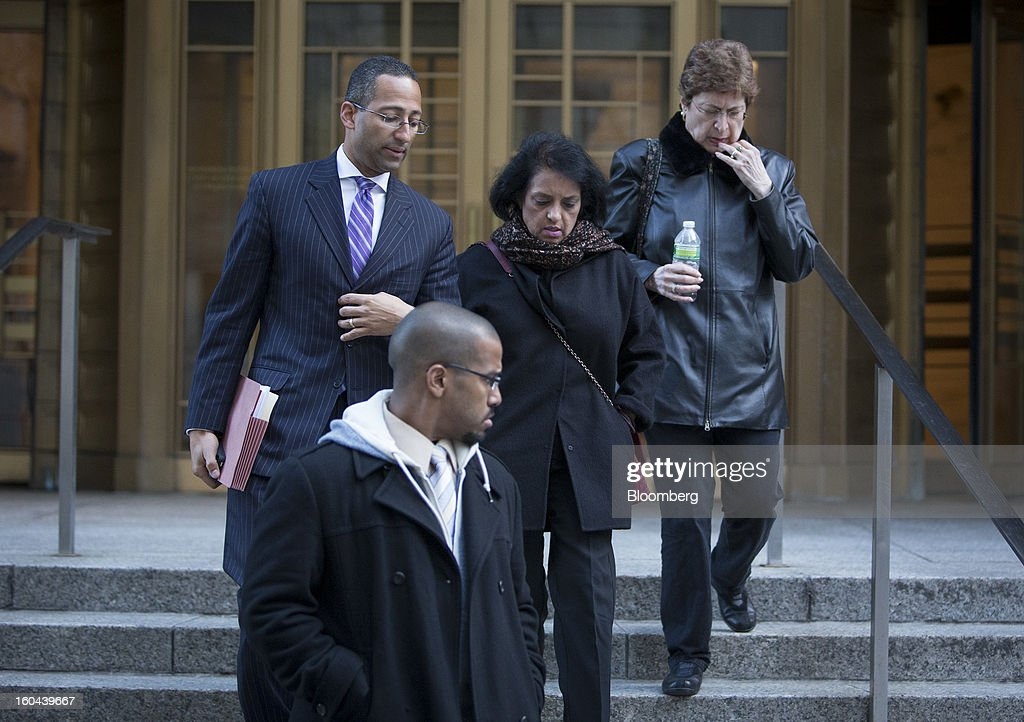 Roomy Khan, a former Intel Corp. executive, center, exits federal court with her lawyer Stanislao German, left, following a sentencing hearing in New York, U.S., on Thursday, Jan. 31, 2013. Khan, twice convicted of passing illegal tips to Raj Rajaratnam, was sentenced to one year in prison today. Photographer: Scott Eells/Bloomberg via Getty Images
