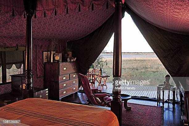 Roomy tent decorated in an elegant 1940s safari style. This offers tourist stylish living in the open veld without compromising any luxuries. Botswana.